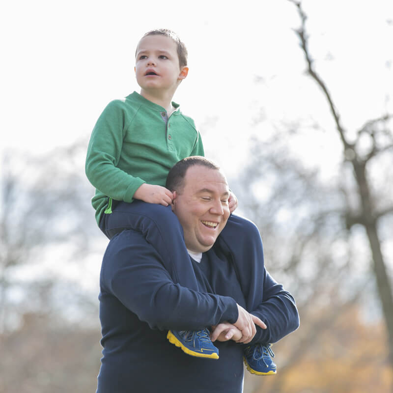 Image: Son on fathers shoulders